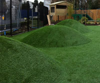 Artificial grass mounds