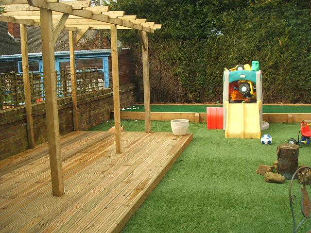 Photos of artificial lawns in gardens for Kid friendly garden design ideas